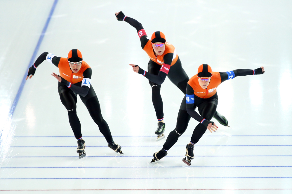 . (L to R) Marrit Leenstra, Jorien ter Mors and Ireen Wust of the Netherlands compete during the Women\'s Team Pursuit Semifinals Speed Skating event on day fifteen of the Sochi 2014 Winter Olympics at  at Adler Arena Skating Center on February 22, 2014 in Sochi, Russia.  (Photo by Ryan Pierse/Getty Images)