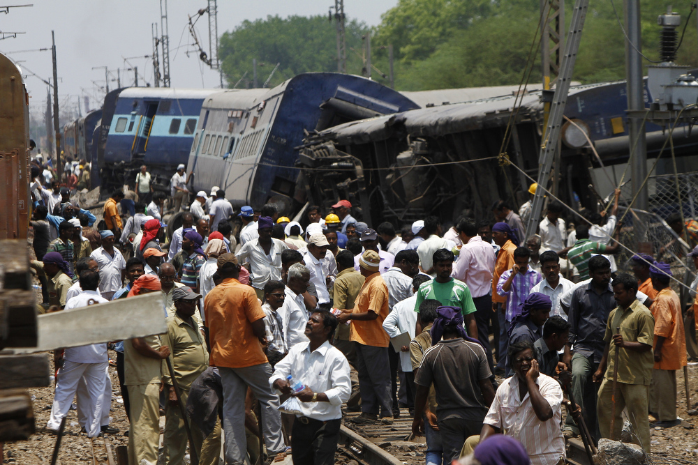 Description of . Indian officials, rescue workers, and bystanders stand amid the wreckage of carriages following a train accident in Chitteri, India\'s southern state of Tamil Nadu, on April 10, 2013. At least two people were killed and many feared injured when a Bangalore-bound train derailed in southern India on Wednesday morning, a railways official told AFP. AFP PHOTO/ STRSTRDEL/AFP/Getty Images