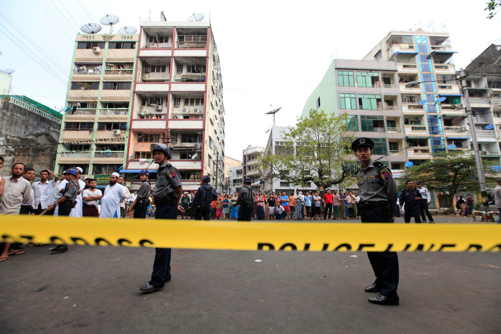 . Police stand near a mosque and school dormitory that were damaged by a fire in Yangon on April 2, 2013. An electrical fire at an Islamic school in Myanmar\'s biggest city killed 13 children early on Tuesday, authorities said. The children, all boys, died of suffocation in the fire at the dormitory of a school next to the  mosque in Yangon at about 2:40 a.m., neighbors and officials said. REUTERS/Soe Zeya Tun