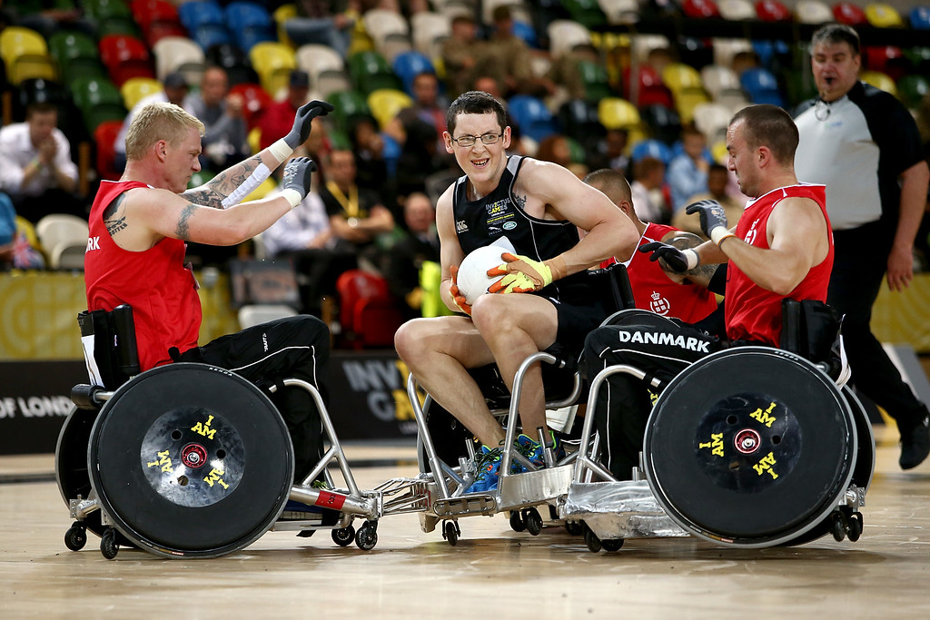 . David Sherriff of New Zealand is tackled during the Wheelchair Rugby match between Denmark and New Zealand during Day Two of the Invictus Games at the Olympic Park on September 12, 2014 in London, England.  (Photo by Jordan Mansfield/Getty Images for Invictus Games)