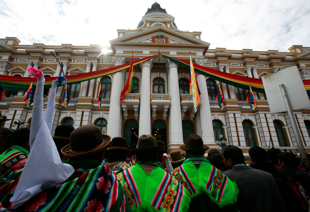 Description of . People gather in front of the congress building during celebrations of third year of the new Pluri-national state of Bolivia and President Evo Morales' eighth continuous year of government, the second longest government in the history of Bolivia, in La Paz January 22, 2013. Morales, first indigenous president in the country's history, will celebrate on Tuesday, 2558 days in the Bolivian Presidency. Morales took office on January 22, 2006, after winning the presidential election with 53.7% and he was re-elected for a second term on 2010-2015 with 64% of the votes according local media. REUTERS/David Mercado