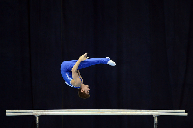 . Ukraine\'s Oleg Stepko competes on  the parallel bars in the men\'s apparatus artistic gymnastics finals during  the 5th European Men\'s and Women\'s  Artistic Gymnastic Individual  Championships in Moscow on April  21, 2013. Ukraine\'s Oleg Stepko took the first place, Switzerland\'s Lucas Fischer took the second place and Russia\'s David Belyavskiy took the third place. NATALIA KOLESNIKOVA/AFP/Getty Images