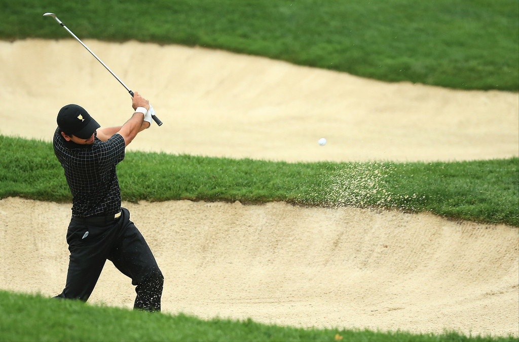 . Jason Day of Australia and the International Team plays a bunker shot on the fourth hole during the Day Four Singles Matches at the Muirfield Village Golf Club on October 6, 2013  in Dublin, Ohio.  (Photo by Andy Lyons/Getty Images)