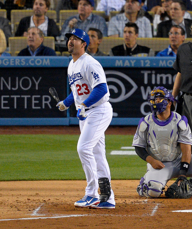 . Los Angeles Dodgers\' Adrian Gonzalez, left, watches his ball go out or a two-run home run as Colorado Rockies catcher Wilin Rosario looks on during the first inning of their baseball game, Wednesday, May 1, 2013, in Los Angeles. (AP Photo/Mark J. Terrill)