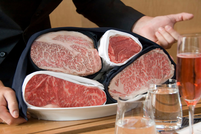 the white wrapped beef is the American wagyu and the black wrapped beef is the Japanese wagyu.  the Japanese wagyu obviously tastes much better.
