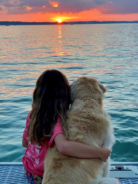 My daughter Mia and dog Pippa enjoying the sunset on the 4th of July.jpg