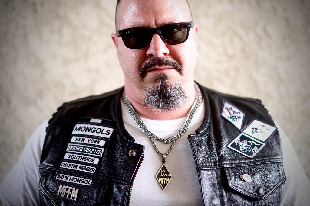 . Diablo, of the New York Mongols, poses as motorcycle club members rally Saturday, March 29, 2013 at The House Lounge in Maywood in support of the Mongols who are facing a federal trial seeking to take away their trademark patch. (Photo by Sarah Reingewirtz/Pasadena Star-News)