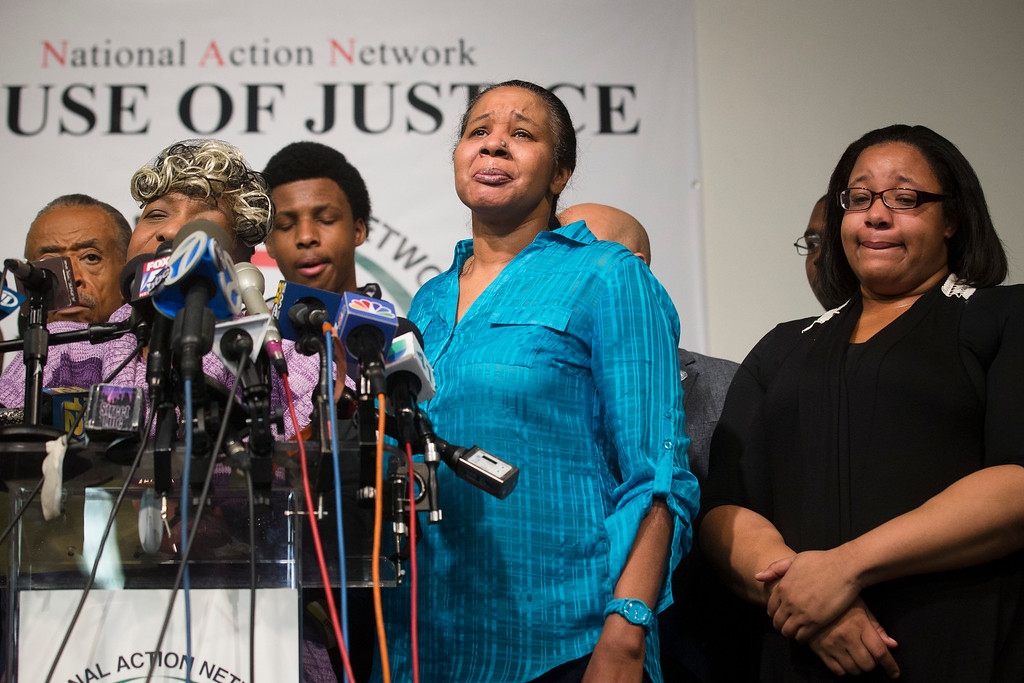 . Esaw Garner, center, wife of Eric Garner, participates in a news conference at National Action Network headquarters in New York on Wednesday, Dec. 3, 2014 after a grand jury\'s decision not to indict a New York police officer involved in her husband\'s death. A video shot by an onlooker and widely viewed on the Internet showed the 43-year-old Garner telling a group of police officers to leave him alone as they tried to arrest him. The city medical examiner ruled Garner\'s death a homicide and found that a chokehold contributed to it. (AP Photo/John Minchillo)