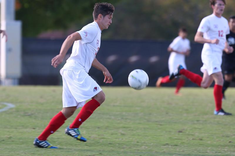 Alejandro Rivillas kicks the ball down the field.
