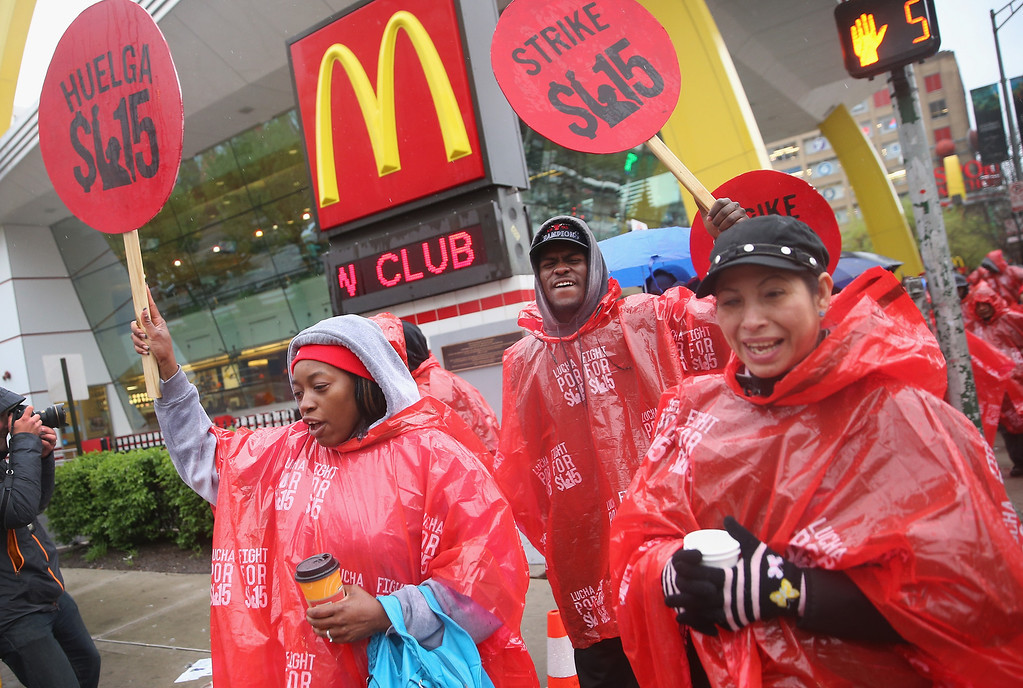 . Fast food workers and activists demonstrate outside McDonald\'s downtown flagship restaurant on May 15, 2014 in Chicago, Illinois.  (Photo by Scott Olson/Getty Images)