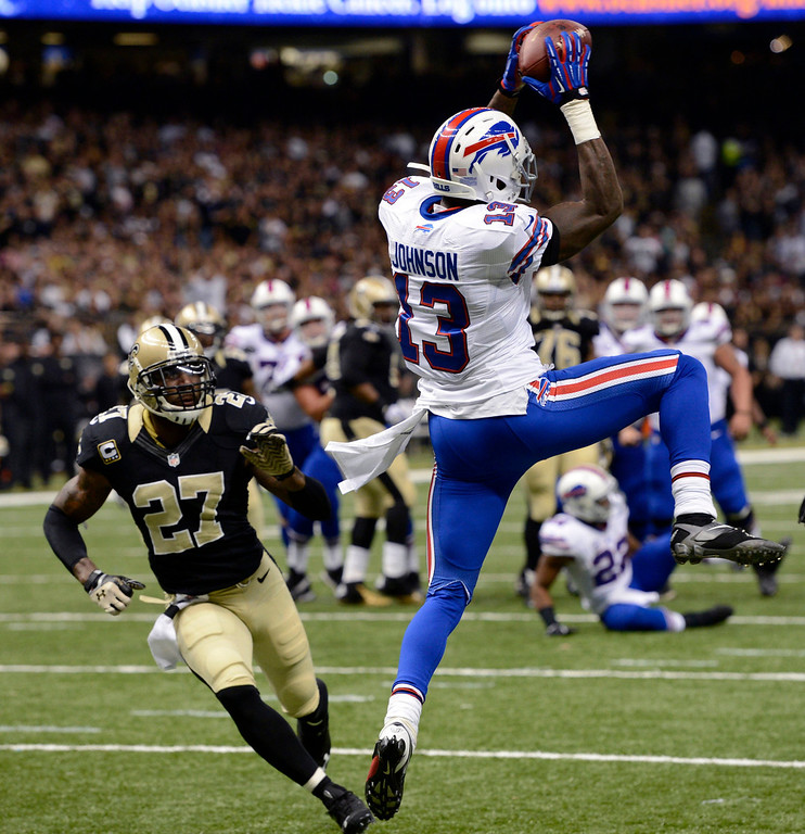 . Buffalo Bills wide receiver Steve Johnson (13) pulls in a touchdown reception in front of New Orleans Saints free safety Malcolm Jenkins (27) during the first half of an NFL football game in New Orleans, Sunday, Oct. 27, 2013. (AP Photo/Bill Feig)
