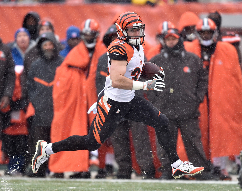 . Cincinnati Bengals running back Rex Burkhead (33) runs for a first down in the first half of an NFL football game against the Cleveland Browns, Sunday, Dec. 11, 2016, in Cleveland. (AP Photo/David Richard)