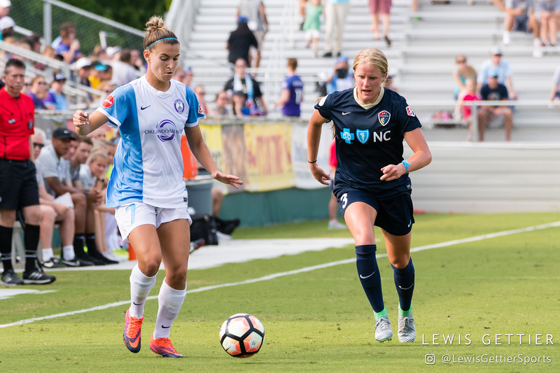 Steph Catley (7) and Makenzy Doniak (3) during a match between the NC Courage and the Orlando Pride in Cary, NC in Week 3 of the 2017 NWSL season. Photo by Lewis Gettier.