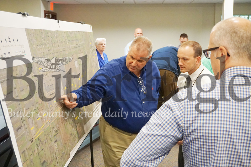 Photo by J.W. Johnson Jr.Officials and residents review plans for the Route 228 Gateway Project on Thursday at the Cranberry Township Municipal Building.