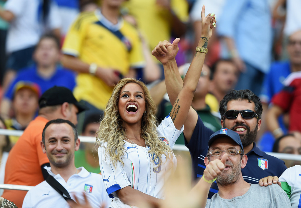 . \\Fanny Neguesha, fiancee of Mario Balotelli of Italy, cheers in the crowd during the 2014 FIFA World Cup Brazil Group D match between England and Italy at Arena Amazonia on June 14, 2014 in Manaus, Brazil.  (Photo by Claudio Villa/Getty Images)