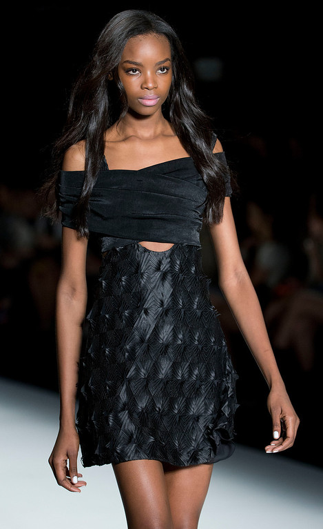 . Angolan model Maria Borges wears a creation from the Tufi Duek Summer collection at Sao Paulo Fashion Week in Sao Paulo, Brazil, Monday, March 31, 2014. (AP Photo/Andre Penner)