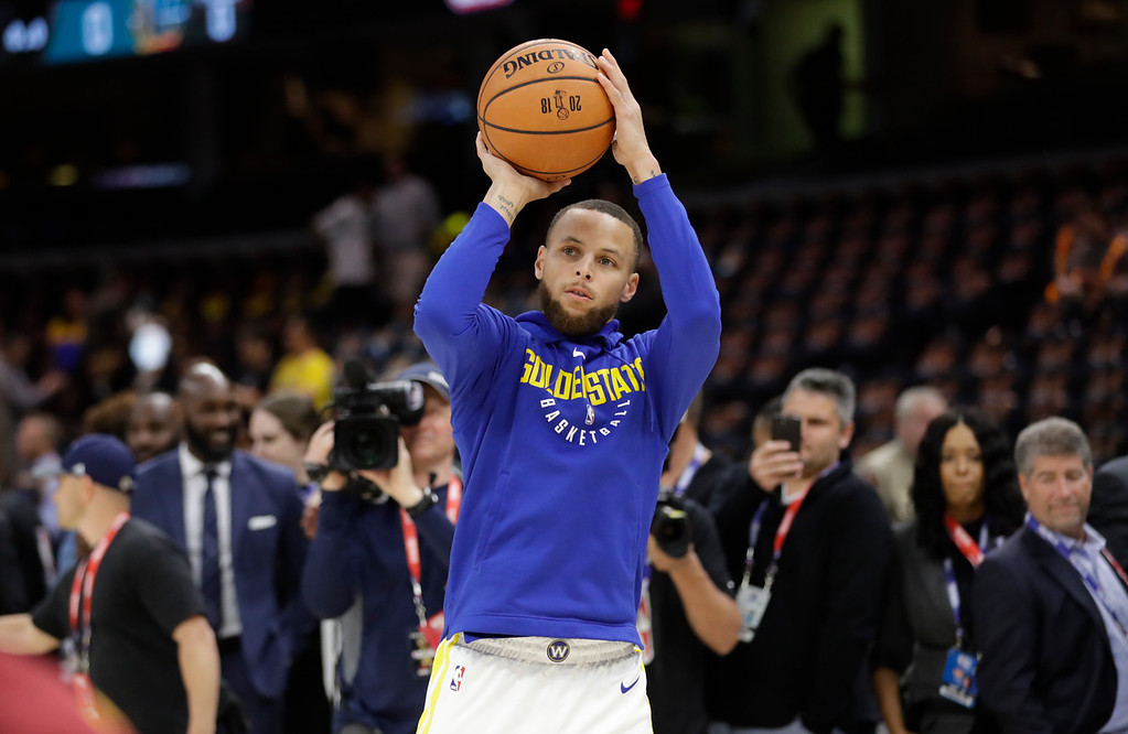. Golden State Warriors guard Stephen Curry warms up before Game 3 of the basketball team\'s NBA Finals against the Cleveland Cavaliers, Wednesday, June 6, 2018, in Cleveland. (AP Photo/Tony Dejak)
