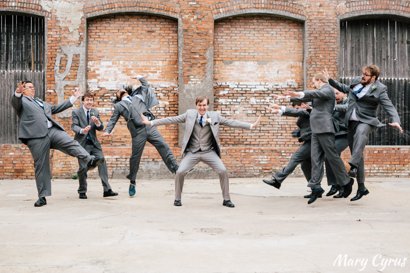 Matt, the groom, using the Force on his groomsmen at the McKinney Cotton Mill | Photo by Mary Cyrus Photography - Weddings & Portraits in Dallas & Beyond