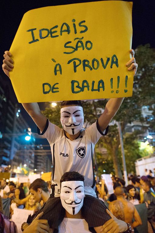 . Demonstrators hold a banner before clashes late on June 19, 2013 in the center of Niteroi, 10 kms from Rio de Janeiro. Protesters battled police late on June 19, even after Brazil\'s two biggest cities rolled back the transit fare hikes that triggered two weeks of nationwide protests.  The fare rollback in Sao Paulo and Rio de Janeiro marked a major victory for the protests, which are the biggest Brazil has seen in two decades.  CHRISTOPHE SIMON/AFP/Getty Images