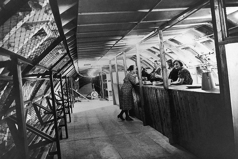 . A canteen in one of London\'s new deep underground air raid shelters on Oct. 20, 1942. Note the line of bunks which are convertible into seats on the left wall. (AP Photo)