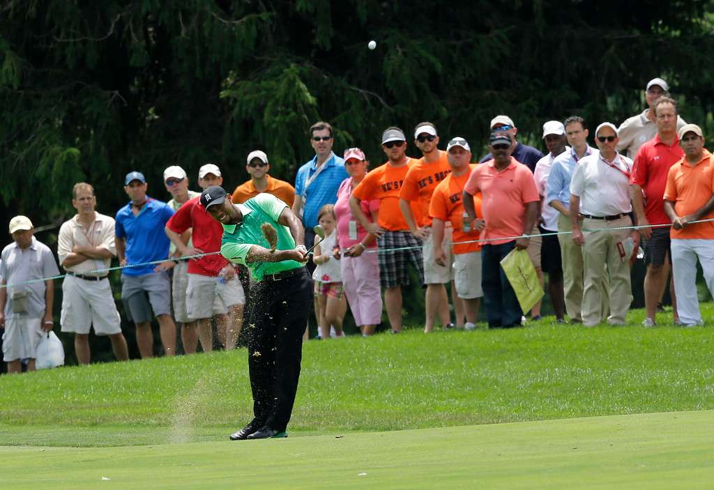 . Tiger Woods hits from the eighth fairway during the first round of the Quicken Loans National PGA golf tournament, Thursday, June 26, 2014, in Bethesda, Md. (AP Photo/Patrick Semansky)