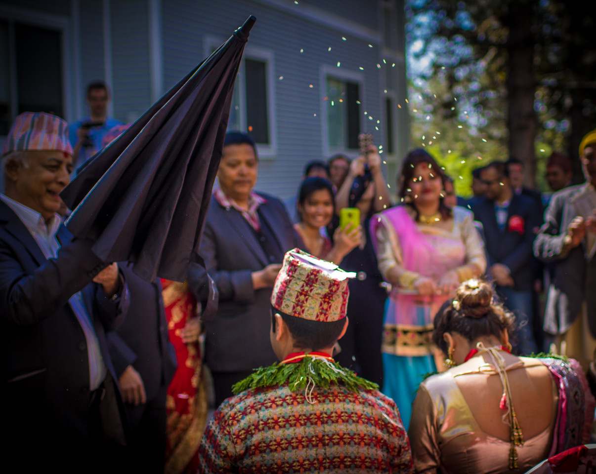 Confetti being thrown at a colorful Hindu wedding in Vermont