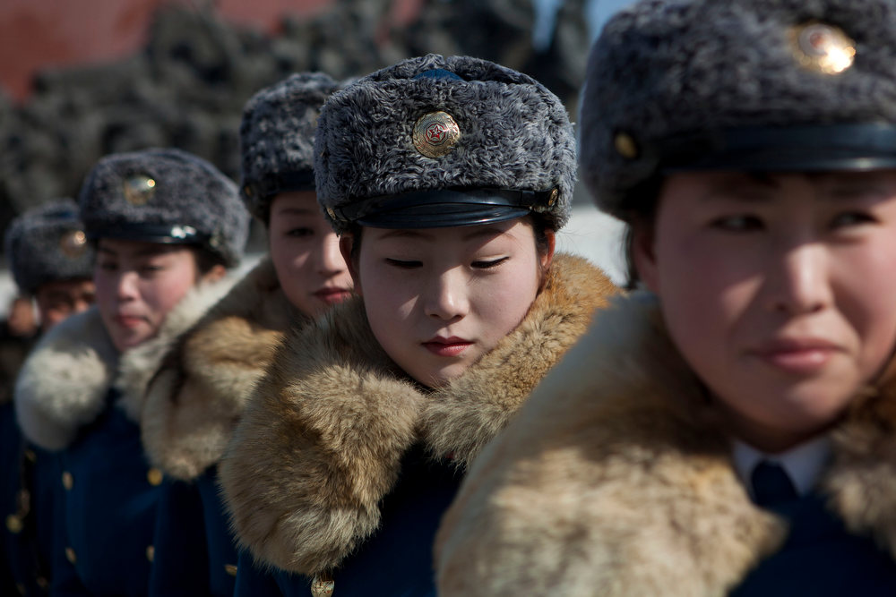 . Female North Korean traffic police officers gather in front of bronze statues of the late leaders Kim Il Sung and Kim Jong Il to pay their respects in Pyongyang, North Korea on Saturday, Feb. 16, 2013. North Koreans turned out to commemorate what would have been the 71th birthday of Kim Jong Il who died on Dec. 17, 2011. (AP Photo/David Guttenfelder)