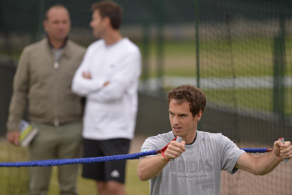 . Britain\'s Andy Murray attends a training session on day eight of the 2013 Wimbledon Championships tennis tournament at the All England Club in Wimbledon, southwest London, on July 2, 2013. ADRIAN DENNIS/AFP/Getty Images