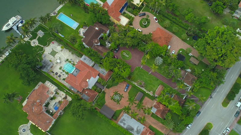 Aerial static video over luxury Miami Beach mansion homes