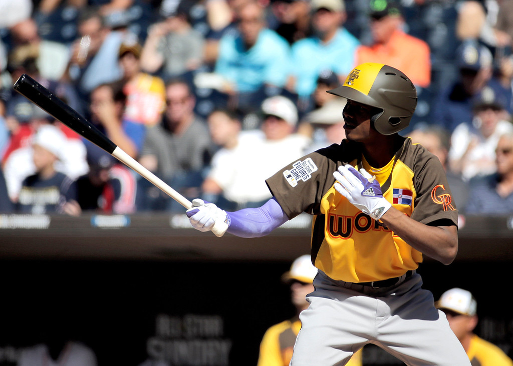 . World Team\'s Raimel Tapia, of the Colorado Rockies, hits against the U.S. Team during the first inning of the All-Star Futures baseball game, Sunday, July 10, 2016, in San Diego. (AP Photo/Matt York)