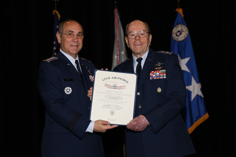 The Exceptional Service Award is presented to Lt Col Lynn McCauley for exceptional service on the Civil Air Patrol Investment Committee.  Photo by Susan Schneider, CAPNHQ
