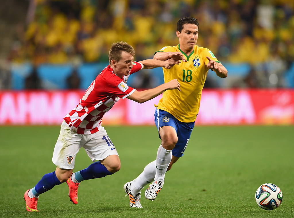 . Hernanes of Brazil is challenged by Luka Modric of Croatia in the second half during the 2014 FIFA World Cup Brazil Group A match between Brazil and Croatia at Arena de Sao Paulo on June 12, 2014 in Sao Paulo, Brazil.  (Photo by Buda Mendes/Getty Images)