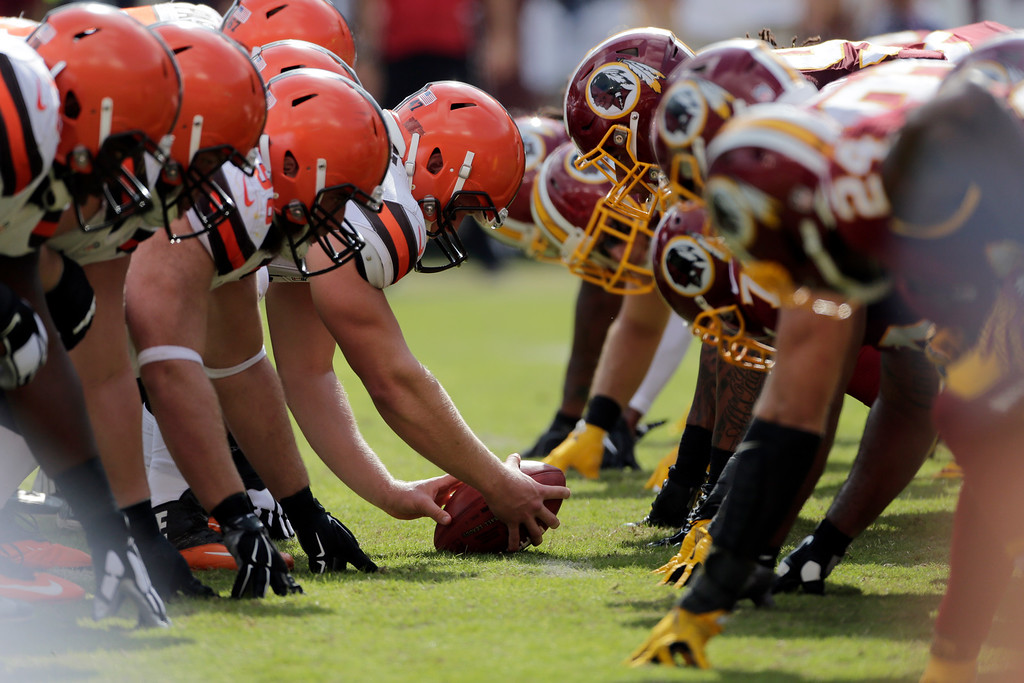 . The Cleveland Browns and Washington Redskins man the line of scrimmage during the second half of an NFL football game Sunday, Oct. 2, 2016, in Landover, Md. (AP Photo/Mark Tenally)