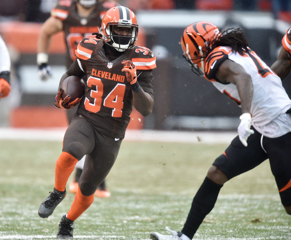 . Cleveland Browns running back Isaiah Crowell (34) runs for a first down in the second half of an NFL football game against the Cincinnati Bengals, Sunday, Dec. 11, 2016, in Cleveland. (AP Photo/David Richard)