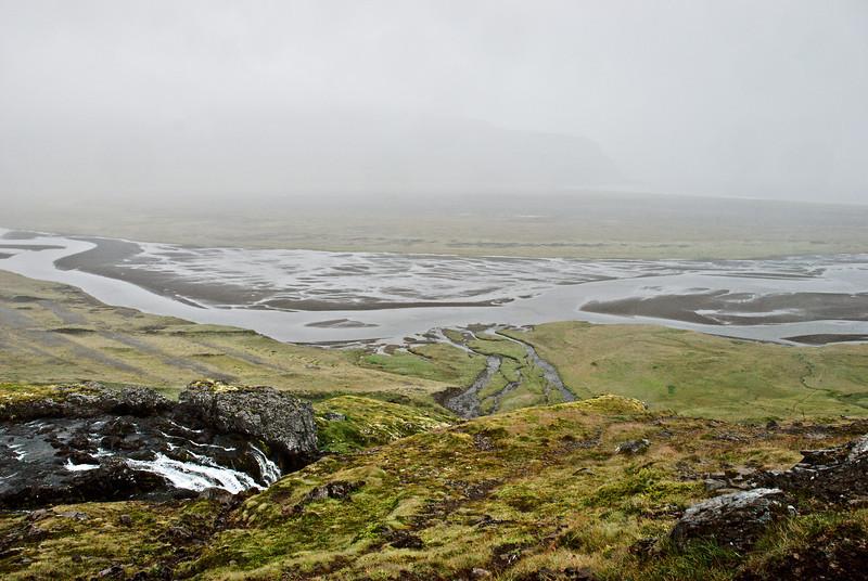 Horft yfir Kýrvað í Hafnarós. Kýrá í forgrunni.