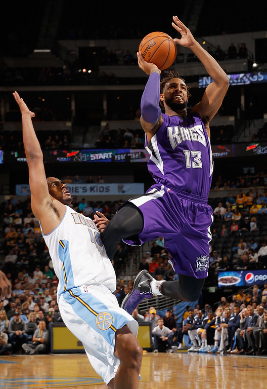 . DENVER, CO - NOVEMBER 03:  Derrick Williams #13 of the Sacramento Kings takes a shot against Arron Afflalo #10 of the Denver Nuggets at Pepsi Center on November 3, 2014 in Denver, Colorado. NOTE TO USER: User expressly acknowledges and agrees that, by downloading and or using this photograph, User is consenting to the terms and conditions of the Getty Images License Agreement.  (Photo by Doug Pensinger/Getty Images)
