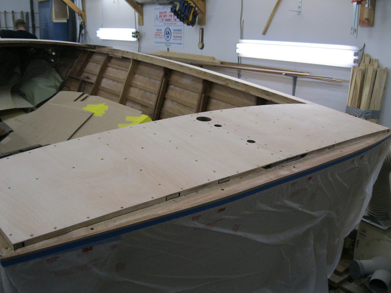 Rear deck plywood sanded with pieces layed out.