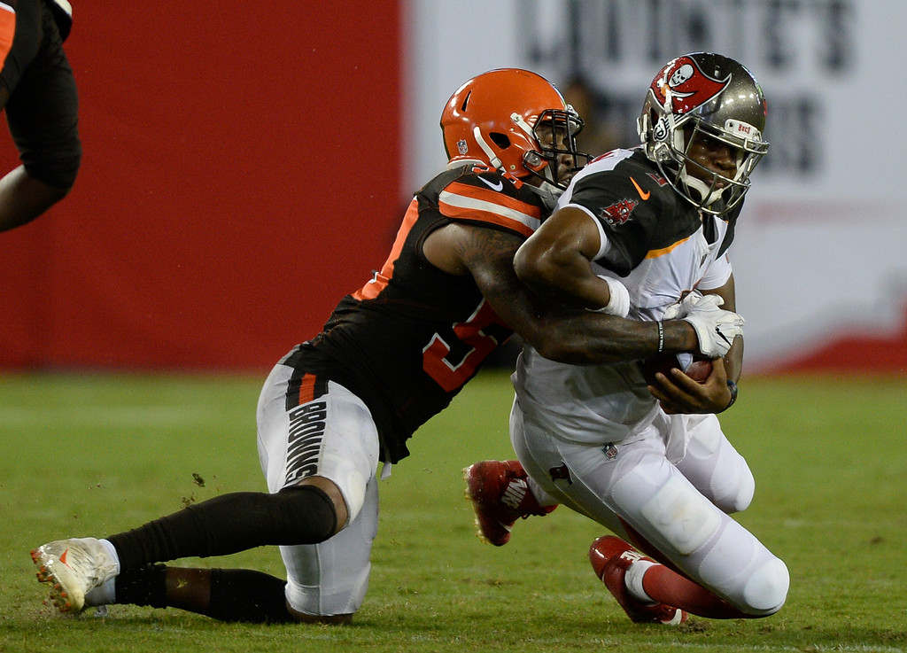 . Tampa Bay Buccaneers quarterback Jameis Winston (3) is sacked by Cleveland Browns inside linebacker Christian Kirksey (58) during the third quarter of an NFL preseason football game Saturday, Aug. 26, 2017, in Tampa, Fla. (AP Photo/Jason Behnken)