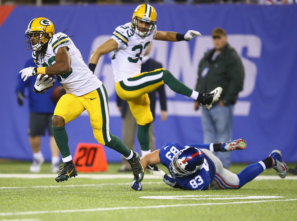 . Tramon Williams #38 of the Green Bay Packers runs after making an interception as  Brandon Myers #83 of the New York Giants misses the tackle during their game at MetLife Stadium on November 17, 2013 in East Rutherford, New Jersey.  (Photo by Al Bello/Getty Images)