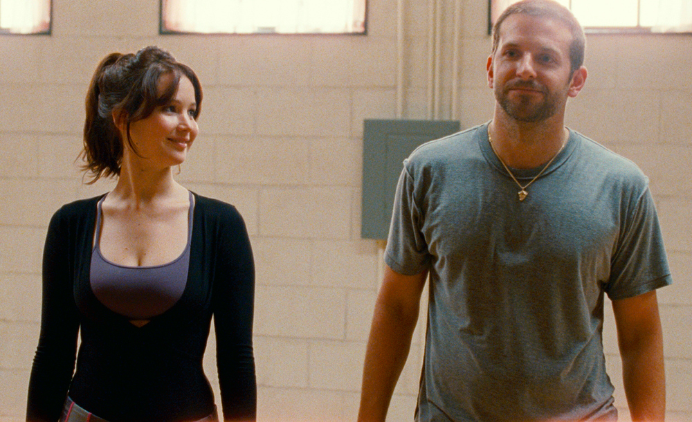 Description of . This film image released by The Weinstein Company shows Jennifer Lawrence, left, and Bradley Cooper in