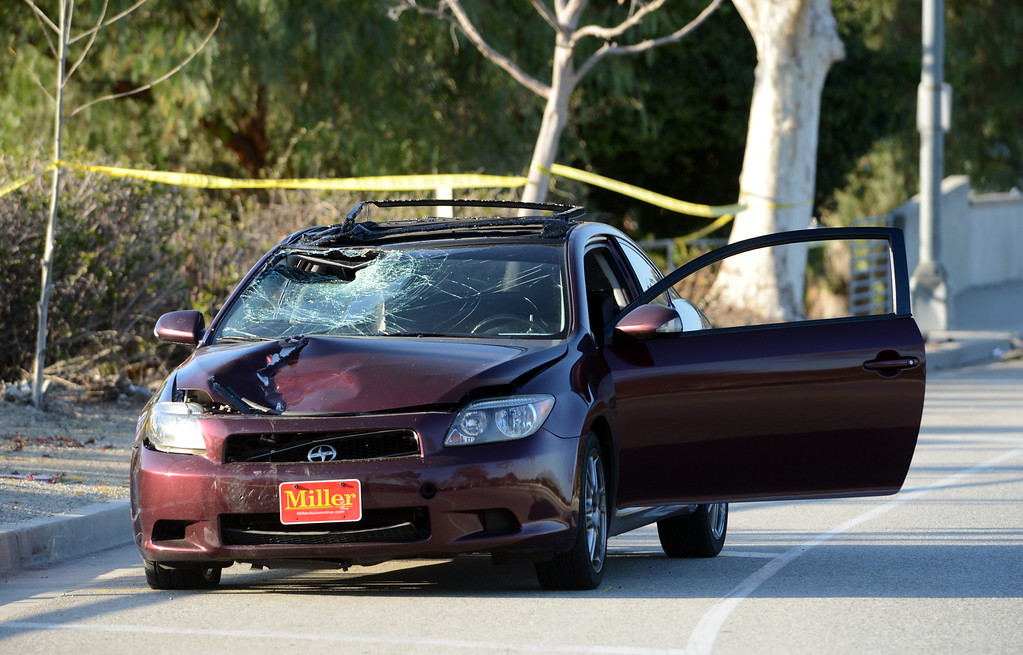 . Pomona Police and California State University Police investigate the scene of a fatality after a car struck a bicyclist Thursday, February 28, 2013, on Kellogg Drive at Cal Poly Pomona in Pomona. Jennifer Cappuccio Maher/Staff Photographer