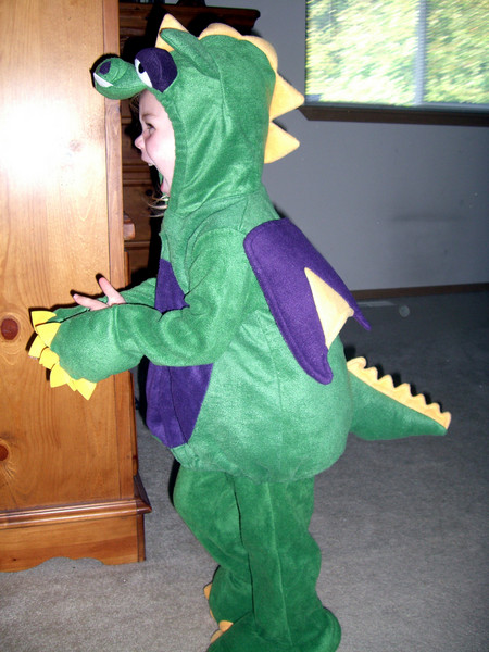 Kimber playing in her dragon Halloween costume. A roar this time!