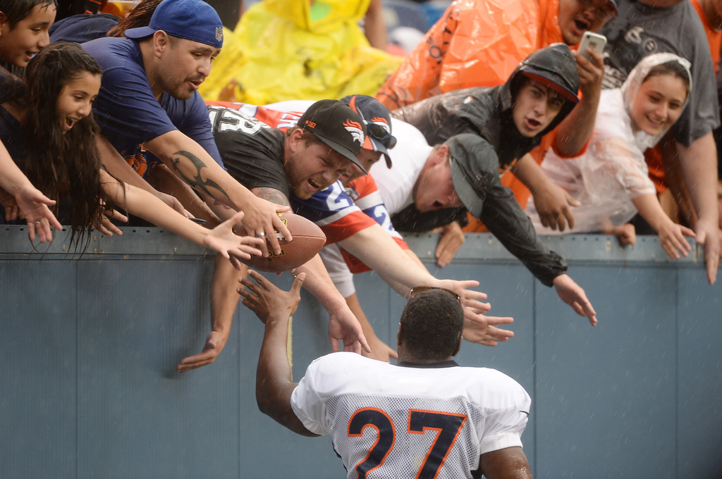 . DENVER, CO. - August 03: Knowshon Moreno of Denver Broncos (27) see fans waiting scrimmage in the rain at Sports Authority Field at Mile High. Denver, Colorado. August 03, 2013. (Photo By Hyoung Chang/The Denver Post)