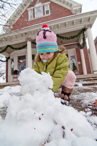 """As I work to shovel up all the snow that fell over night, Freja plays, making a """"snow man."""" It's a good thing we like the cold!"""