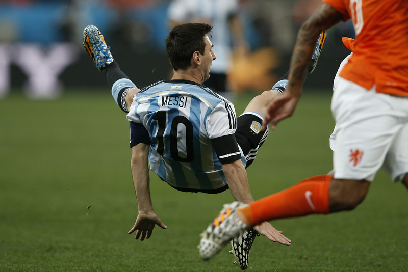 . Argentina\'s forward Lionel Messi falls during the semi-final football match between Netherlands and Argentina of the FIFA World Cup at The Corinthians Arena in Sao Paulo on July 9, 2014. (ADRIAN DENNIS/AFP/Getty Images)