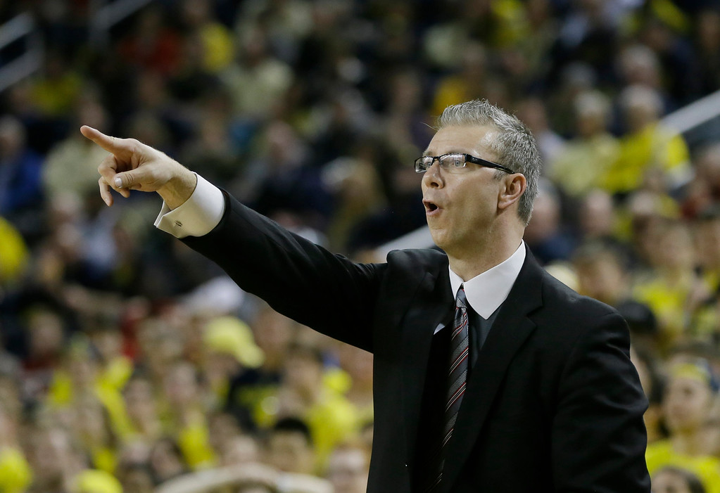 . Ohio State assistant coach Jeff Boals directs from the sidelines during the second half of an NCAA college basketball game against Michigan, Sunday, Feb. 22, 2015 in Ann Arbor, Mich. Michigan defeated Ohio State 64-57. (AP Photo/Carlos Osorio)