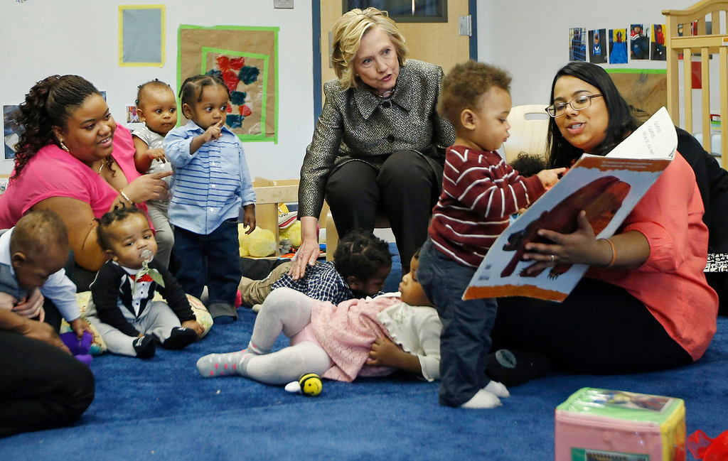 . Hillary Rodham Clinton, center rear, visits children in a classroom at FirstStepNYC, an early childhood development center on April 1, 2015 in the Brooklyn borough of New York City. (Photo by Kathy Willens-Pool/Getty Images)