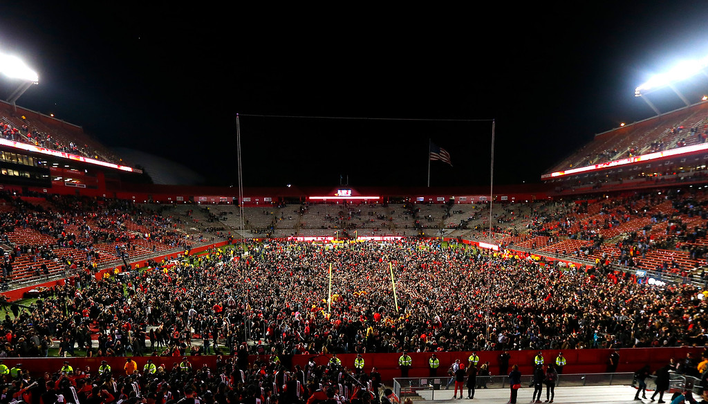 . Rutgers fans flood the field after Rutgers defeated Michigan 26-24 in an NCAA college football game Saturday, Oct. 4, 2014, in Piscataway, N.J. (AP Photo/Rich Schultz)