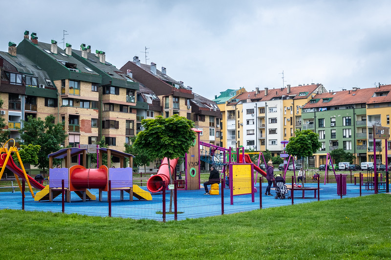 Kids playgrounds are generally fenced in and very colorful.