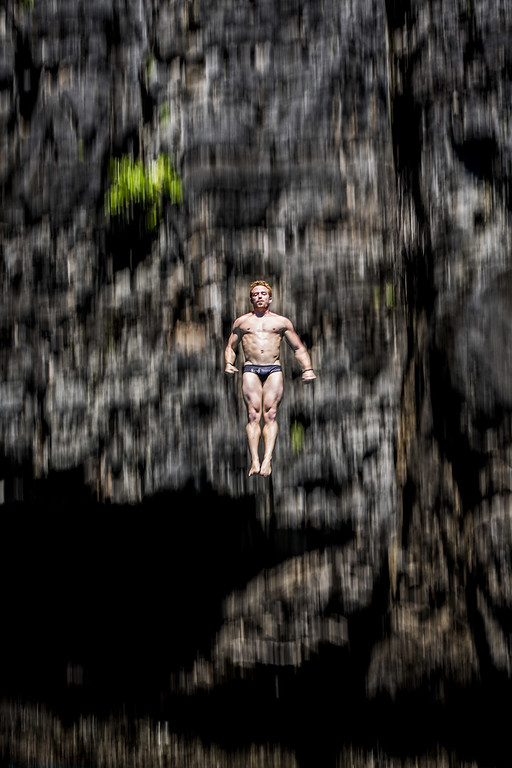 . In this handout image provided by Red Bull, Alain Kohl of Luxembourg dives from the 27 meter platform at Maya Bay in the Andaman Sea during the final stop of the 2013 Red Bull Cliff Diving World Series on October 22, 2013 at Phi Phi Island, Thailand. (Photo by Dean Treml/Red Bull via Getty Images)